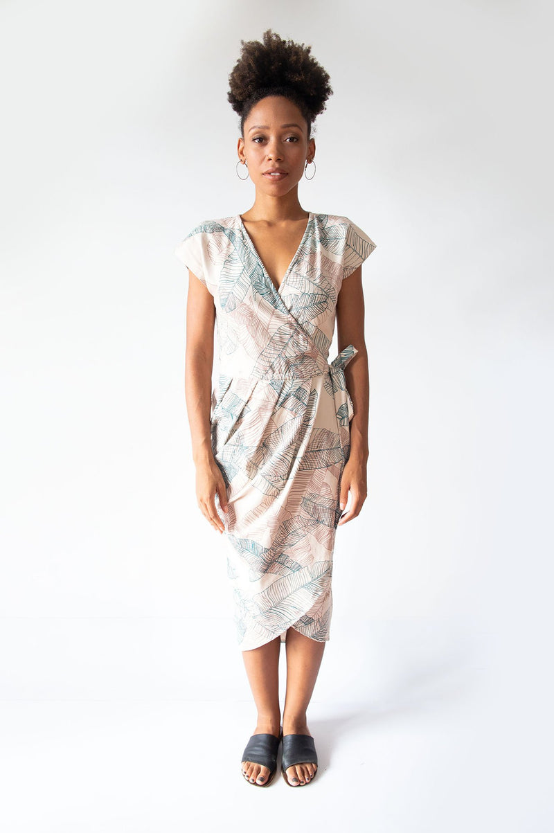 The lotus dress, seen here in cream with a banana palm leaf print, is made from reclaimed jersey as part of our unique zero waste process.