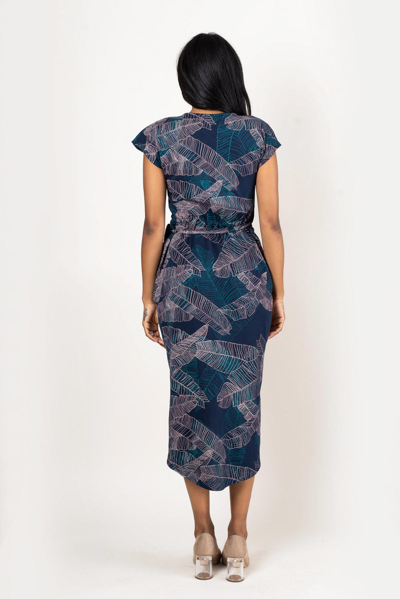 A rear view of the lotus dress in navy with our banana palm print that shows the length of the dress in the back.