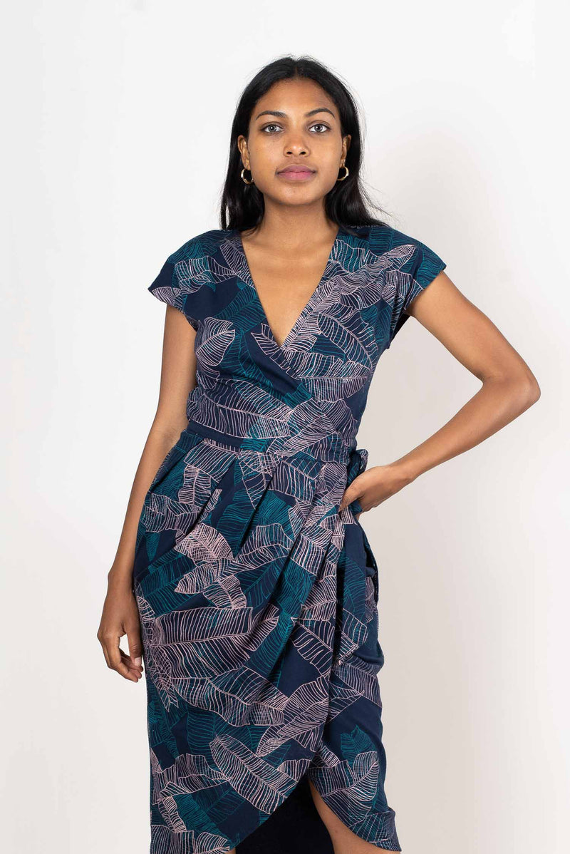 A detail view of our fair fashion lotus dress that shows the intricate hand-printed banana palm leaf design.