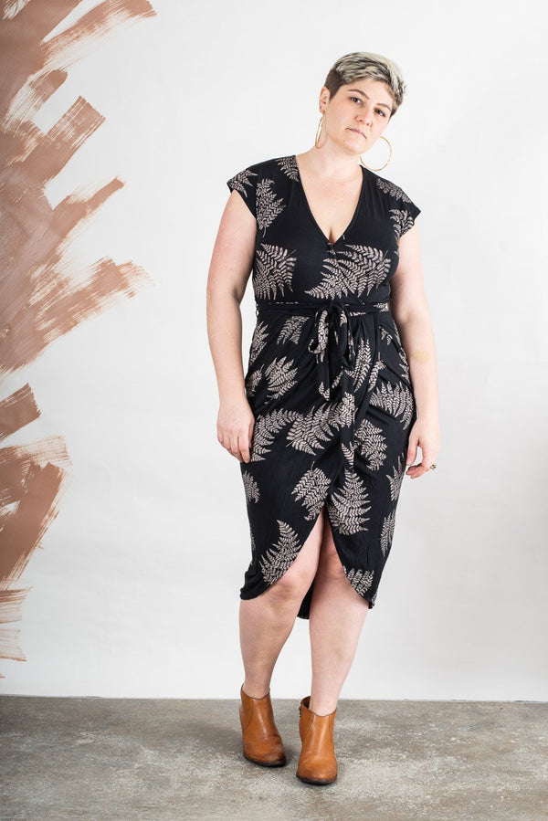 The lotus dress, seen here in black with a fern frond print, is made from reclaimed jersey as part of our unique zero waste process.