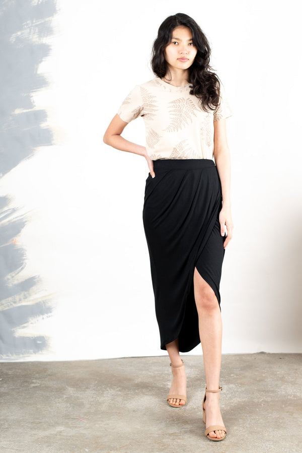 The lotus skirt, seen here in black, is made from reclaimed jersey as part of our unique zero waste process.