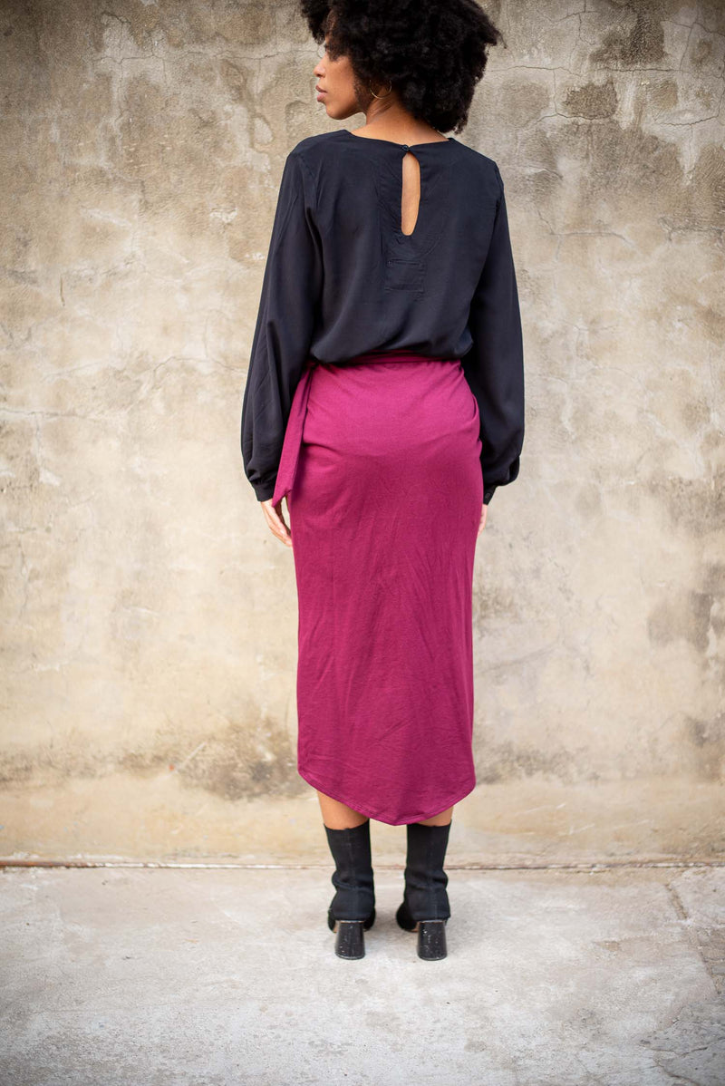 A back view of the circular fashion lotus wrap skirt that shows the length of the hem.
