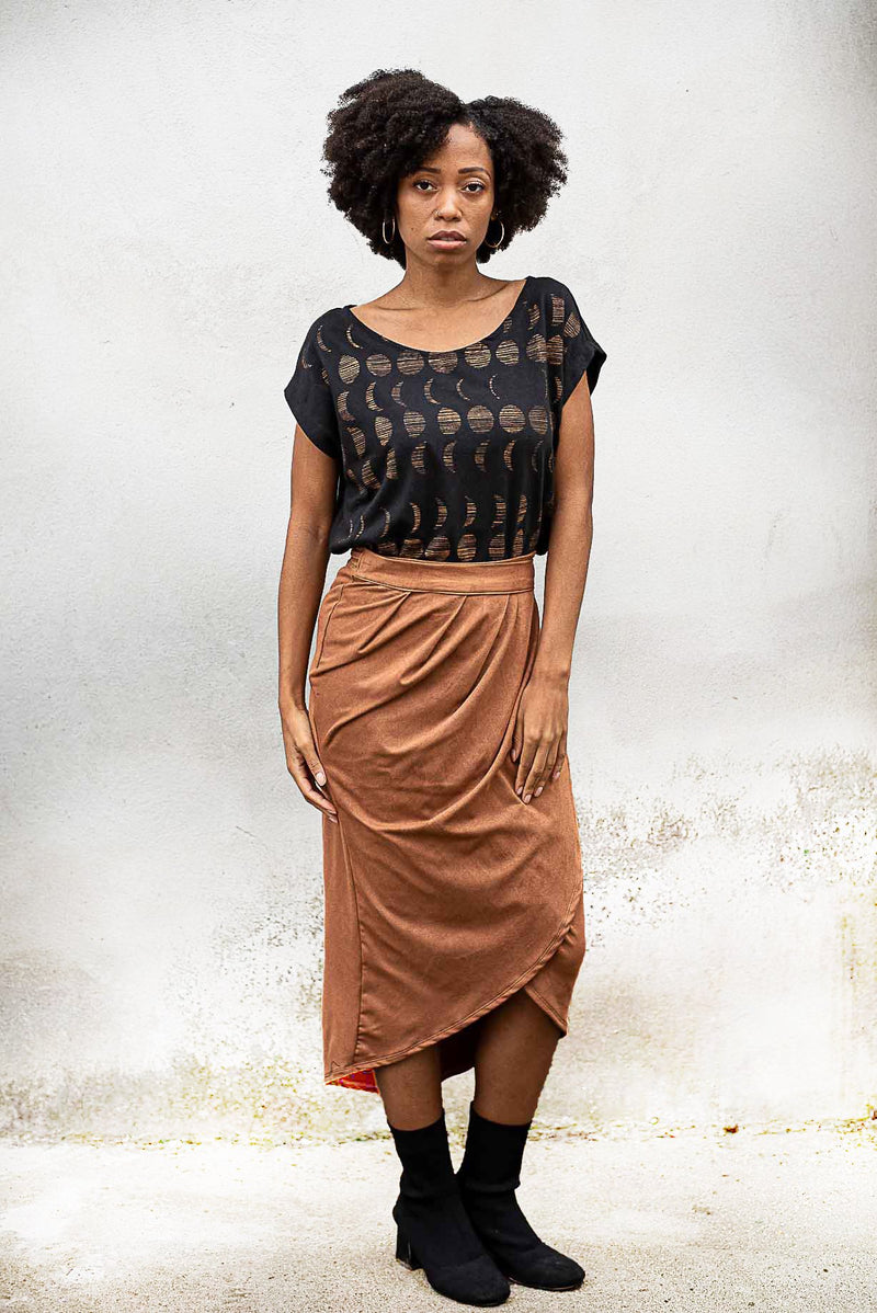 The lotus wrap skirt in copper is sustainably made from reclaimed textiles in our zero waste process.