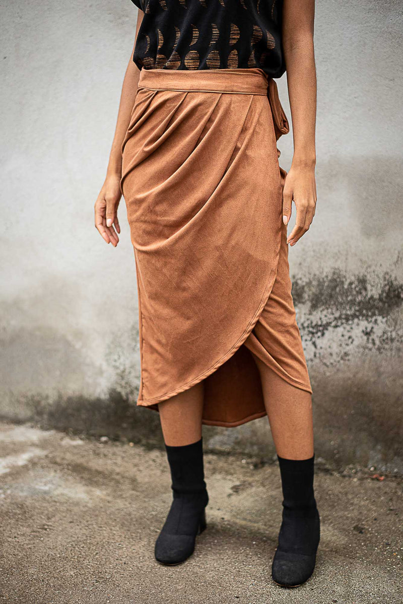 A detail of the ruched waist on our ethically made lotus wrap skirt in copper.