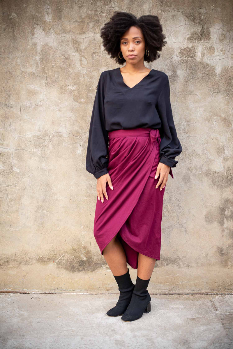 The fair fashion lotus wrap skirt, seen here in wine, can be paired with an elegant top for an evening look.
