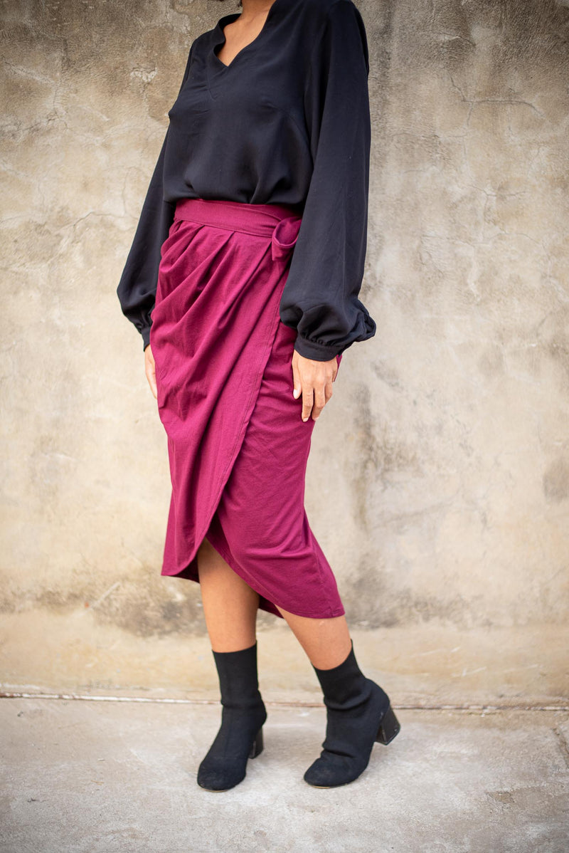 The sustainably made lotus wrap skirt in wine, seen from the side.