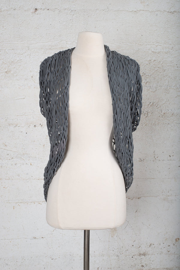 Front view of a hand-knit cardigan on our secondhand, sustainable fashion platform.