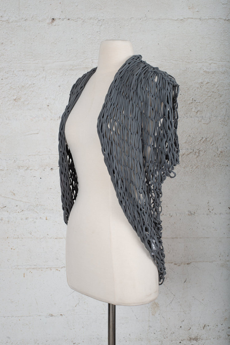 Side angle view of a hand-knit cardigan for resale on our circular fashion site.