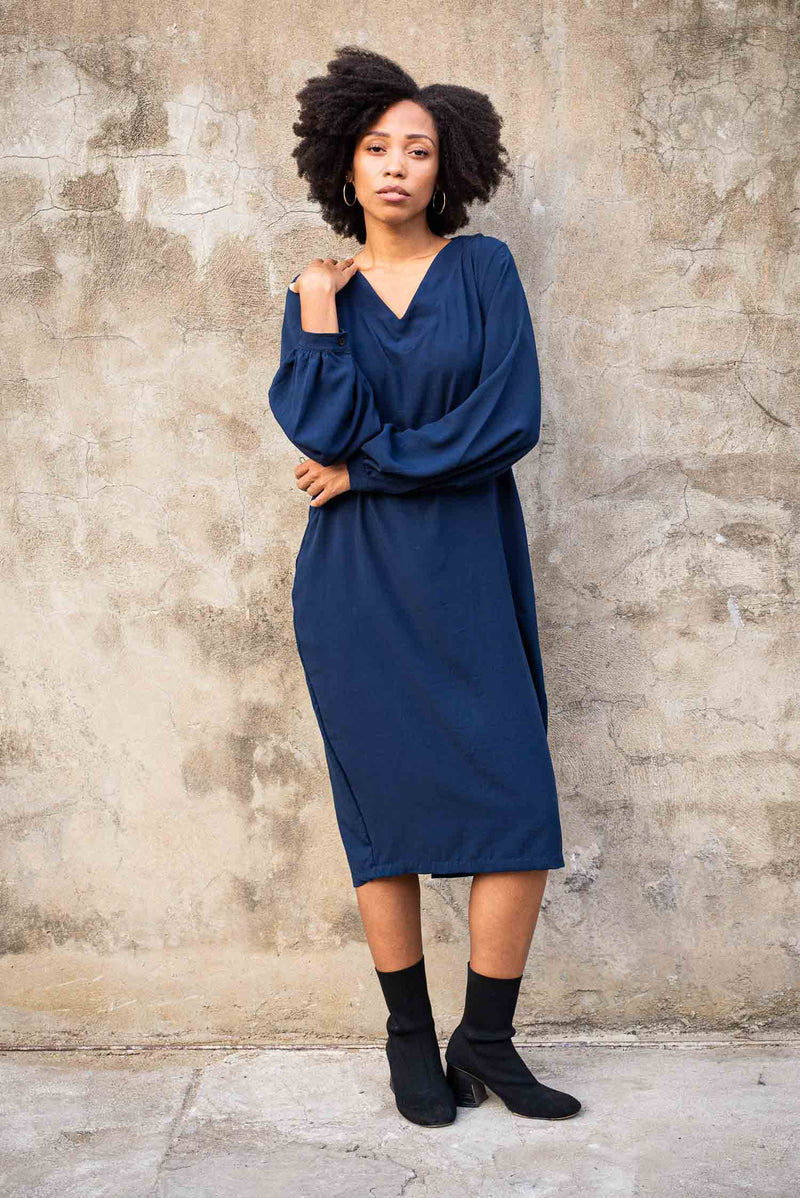 Our ethically made Maly dress is seen here in navy.