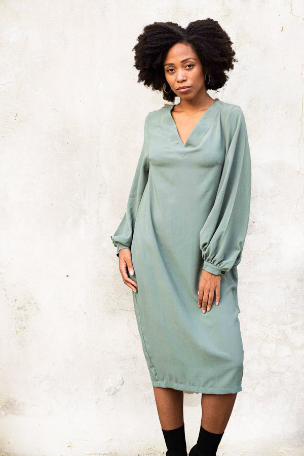 Our Maly dress, seen here in sage, is an elegant design that's comfy and easy to wear.