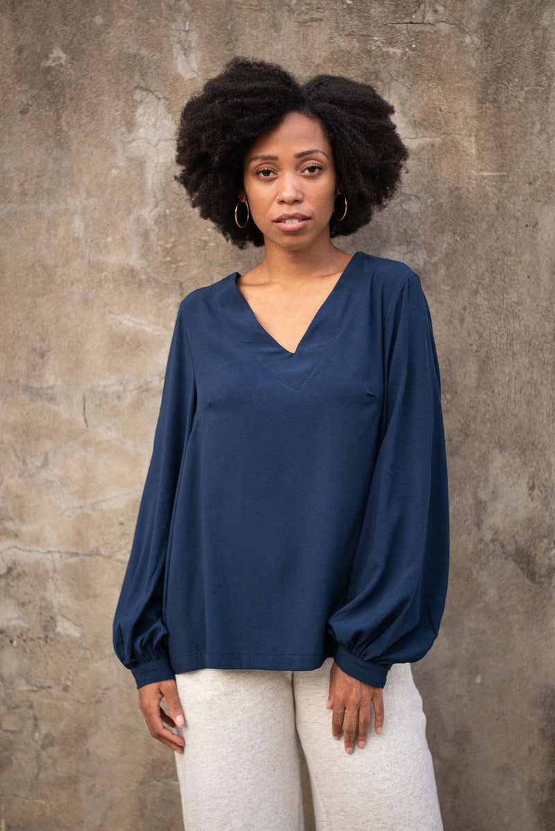 The Maly top, seen here in navy, is made from reclaimed textiles in our zero waste process.