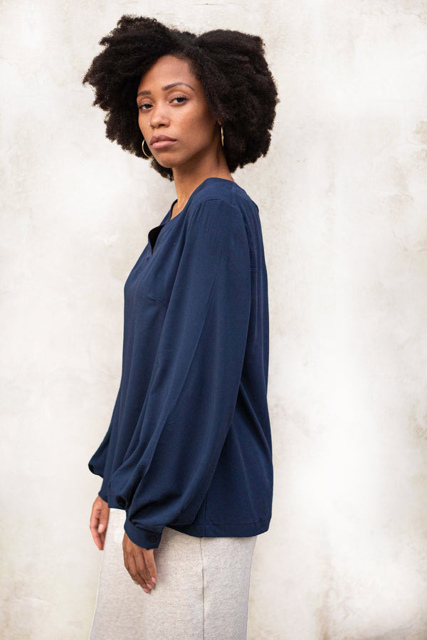 A side view of our ethically made Maly top in navy.