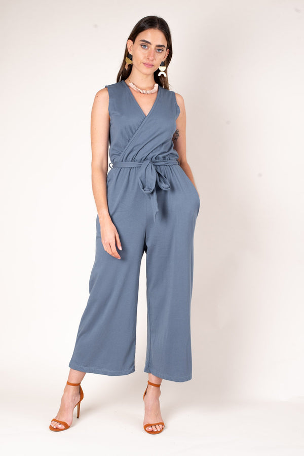 A front view of the dusty blue mandy jumpsuit. This soft jumpsuit is made from reclaimed cotton jersey as part of our unique zero waste process.