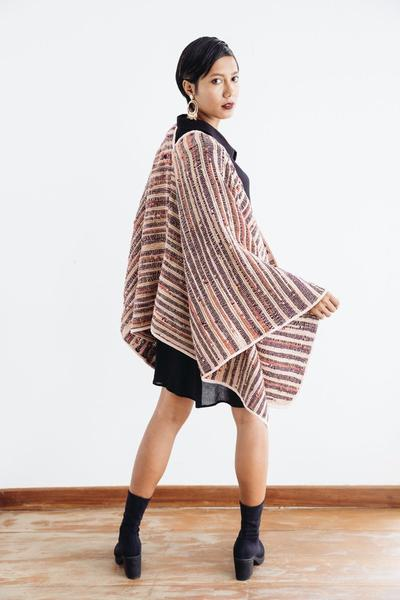A back angle view of our sustainably made Manina cape cardigan shows how it flows over the body.