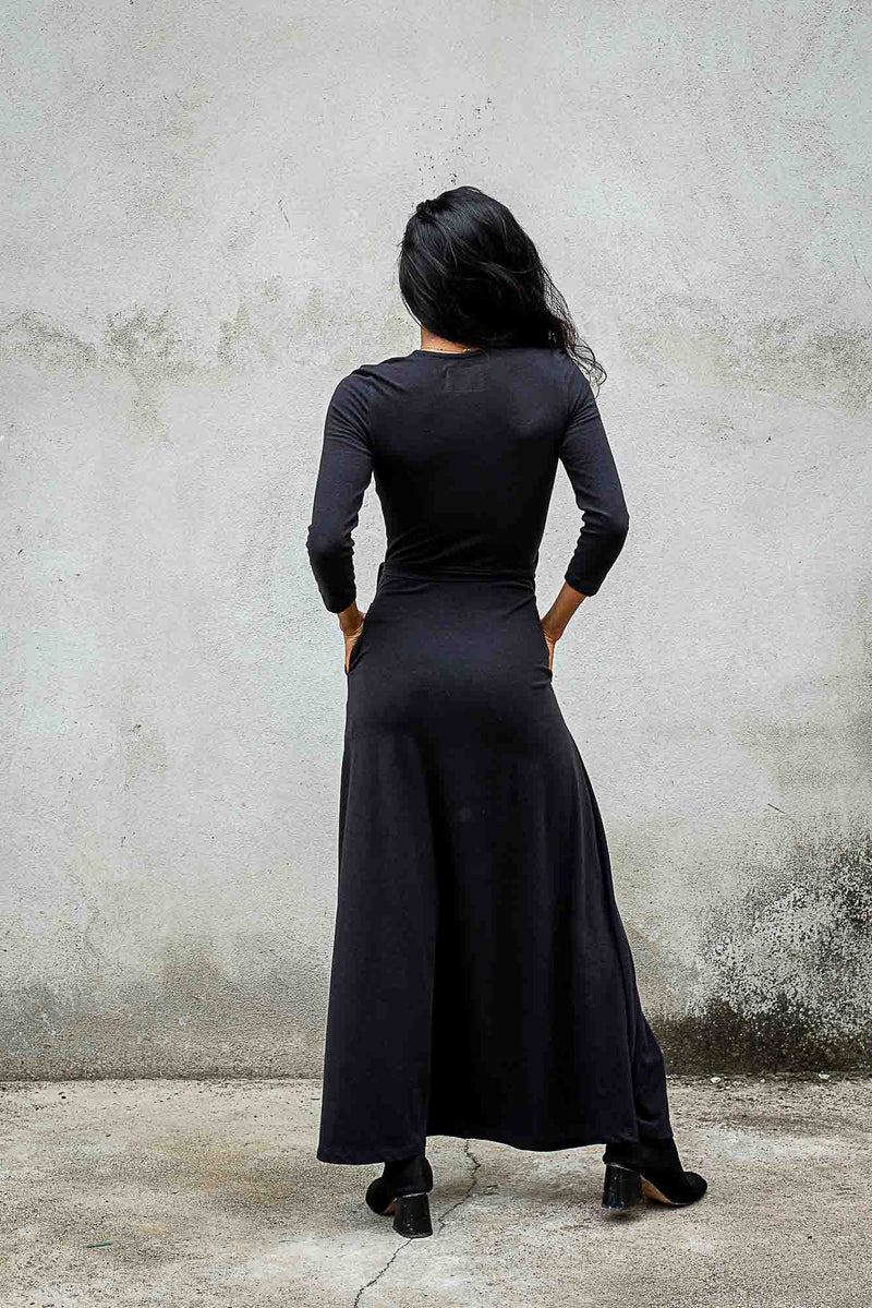 A back view of our maxi wrap dress that shows the form fitting cut and the length of the hem.