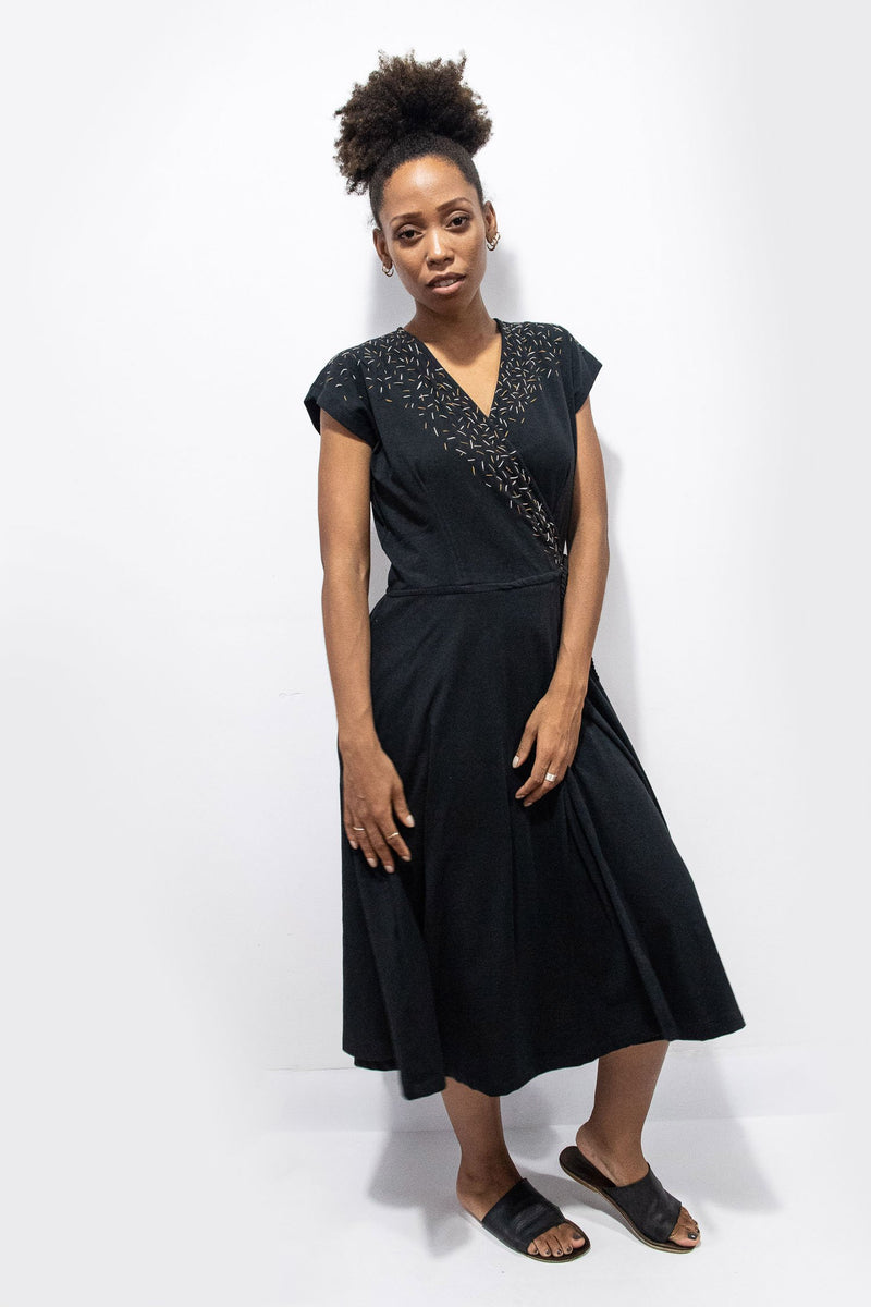 Our sustainably made Mekong wrap dress in black with confetti embroidery.