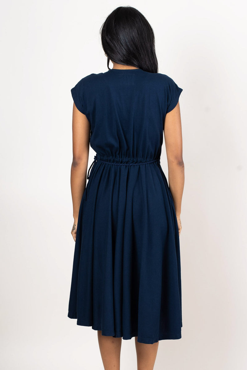 A rear image of our Mekong wrap dress in navy that shows how the tie wraps around the back.