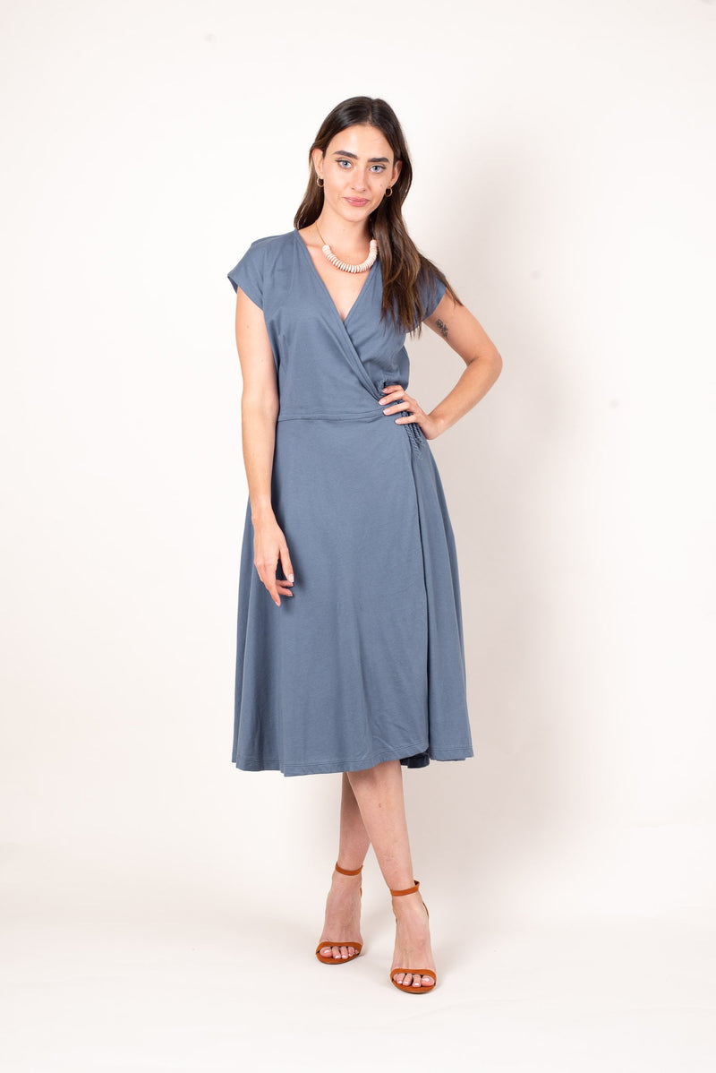 A front view of the dusty blue mekong wrap dress, made from reclaimed jersey as part of our unique zero waste process.