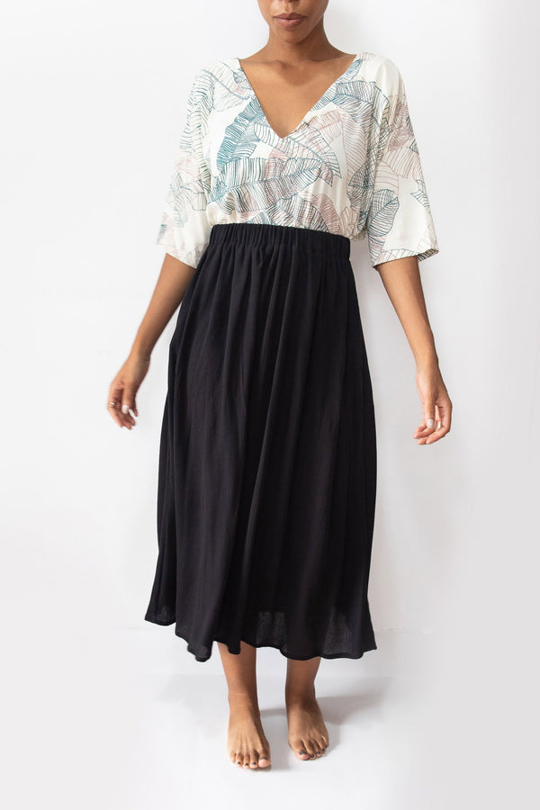 This midi skirt in black crepe is made from reclaimed textiles in our zero waste process.