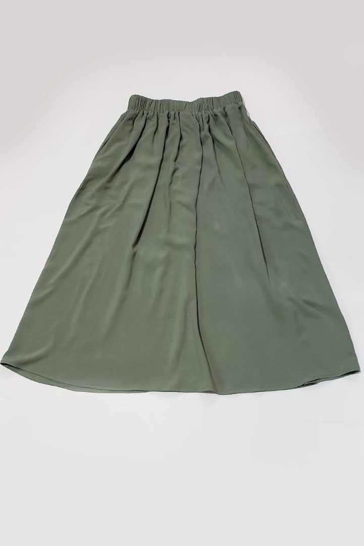 A flat image of our fair fashion midi skirt in sage crepe.