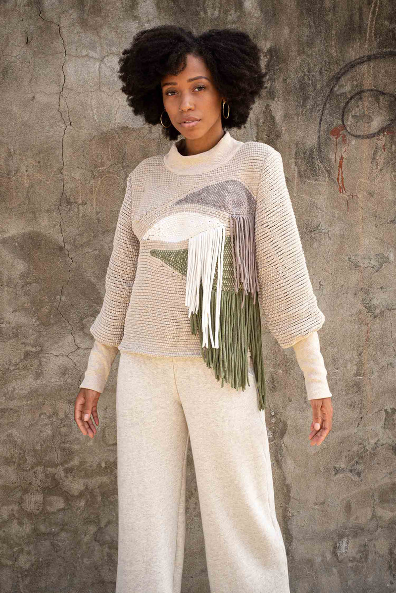 Our sustainable fashion Priya sweater is a strong statement piece. Seen here in khaki and olive.