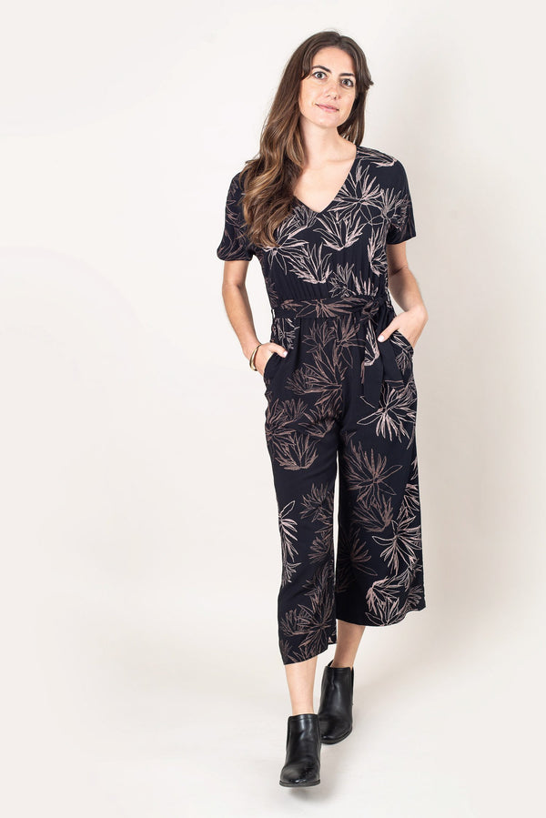 The Rachana jumpsuit, seen here in black with a cactus print, is made from reclaimed rayon as part of our unique zero waste process.
