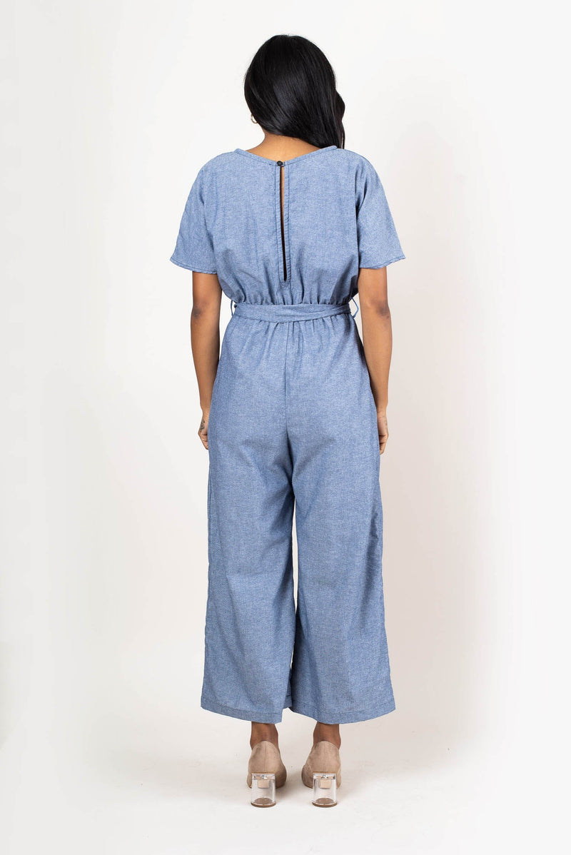 A button closure on the back at the top of the neck makes this jumpsuit easy to get on and off.