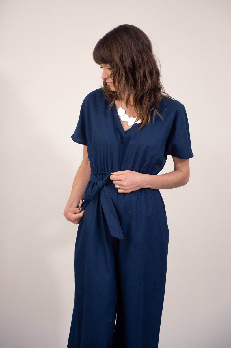 Add elegant accessories to our ethically made Rachana jumpsuit, seen here in navy linen, and you're ready for a night out.