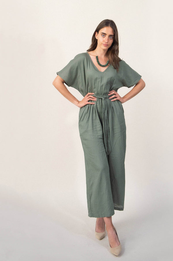 The Rachana jumpsuit, seen here in sage linen, is made from reclaimed textiles as part of our unique zero waste process.