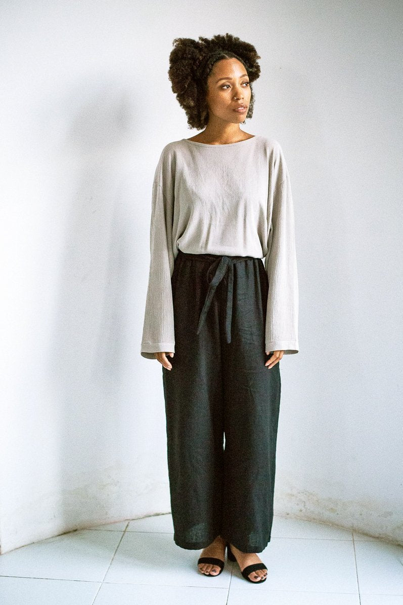 Our relaxed basic top is a staple for any minimalist capsule wardrobe. Seen here in grey crepe.