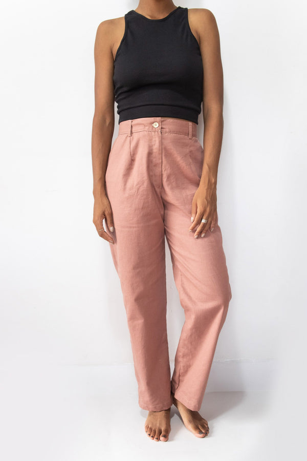 Our ethically made pants, shown here in blush, have a button fly and belt loops.