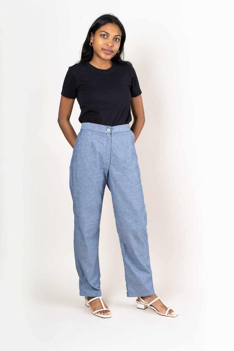 These classic pants are made from reclaimed textiles as part of our unique zero waste process. Seen here in chambray.