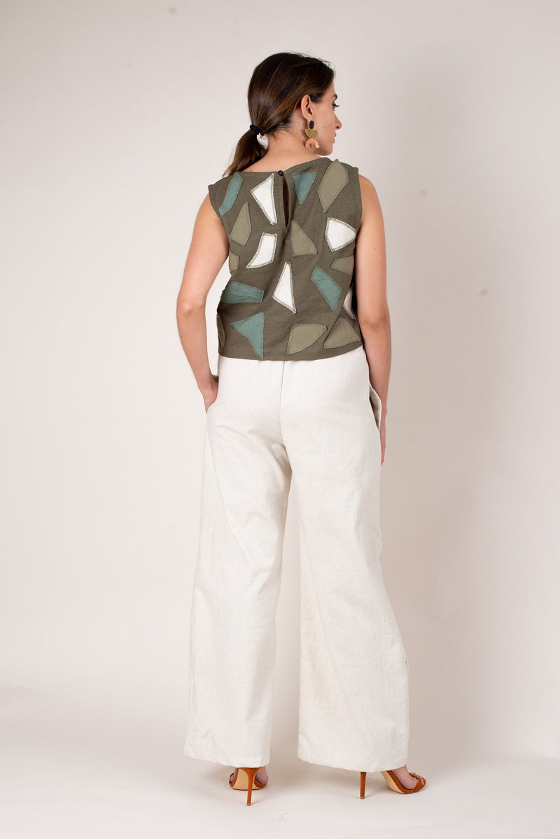 A back view of the olive green boxy sleeveless tank top, showing off the geometric pattern and a keyhole button closure at the back of the neck.