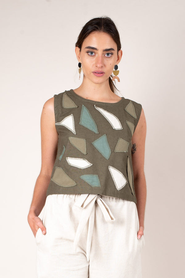 A close up look at the geometric sea-glass designs on our olive green sleeveless tank top, this sustainable fashion top is perfect for spring and summer.