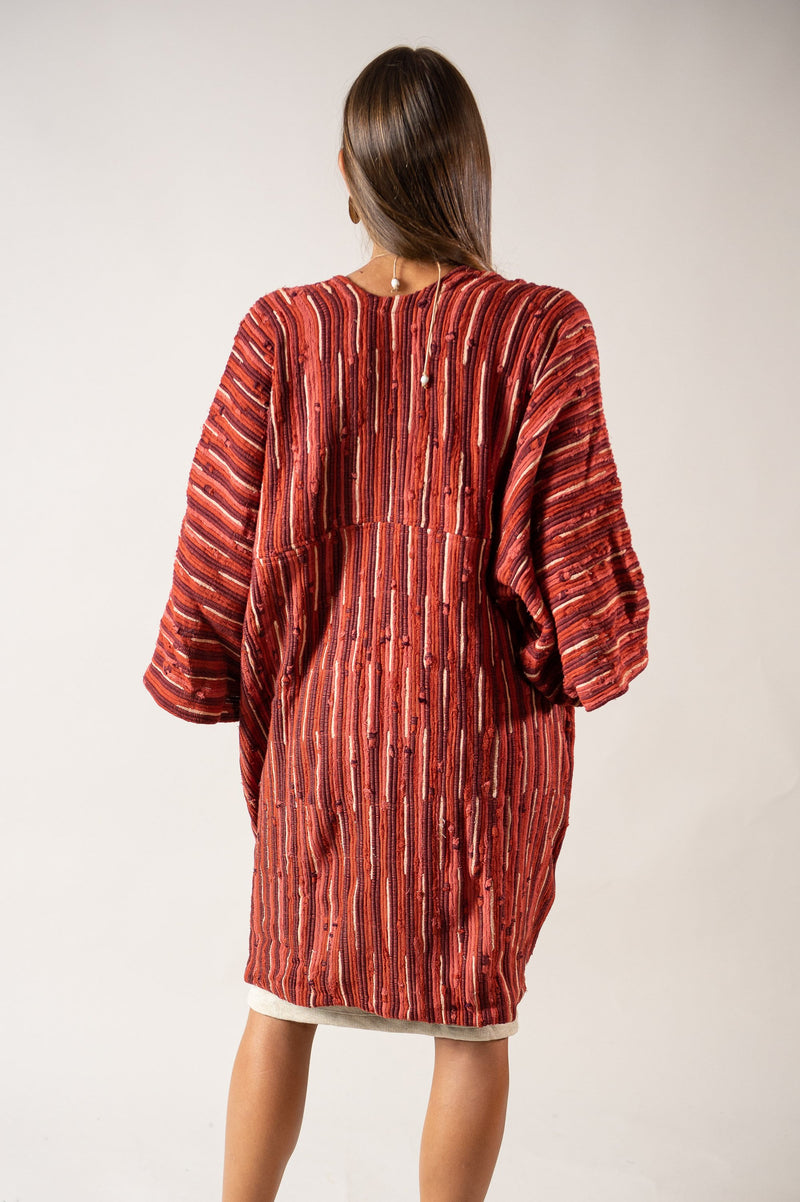 A back view of our fair fashion Seyha jacket that shows the structure and length of the hem.