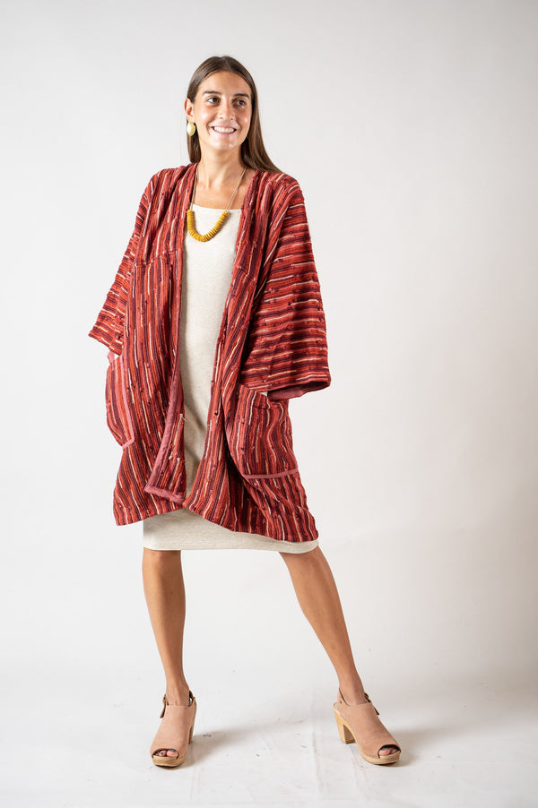 Our ethically made Seyha jacket looks great layered over dresses, as styled here.