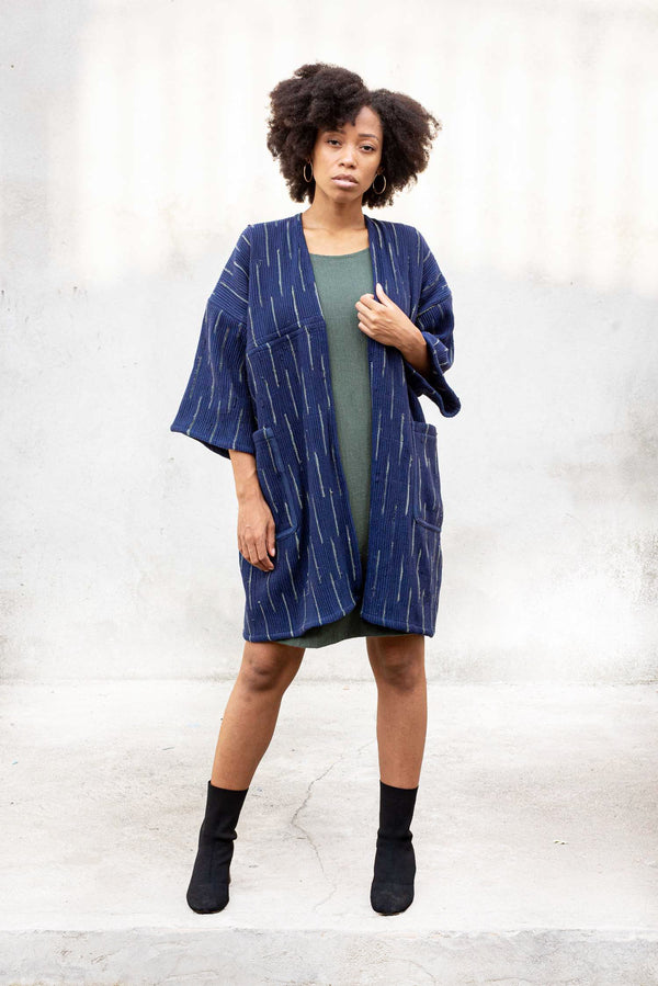 Our circular fashion Seyha jacket, seen here in indigo, has copped sleeves.