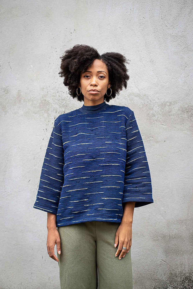 The Seyha sweater, seen here in indigo, is made in our fair fashion workshop.