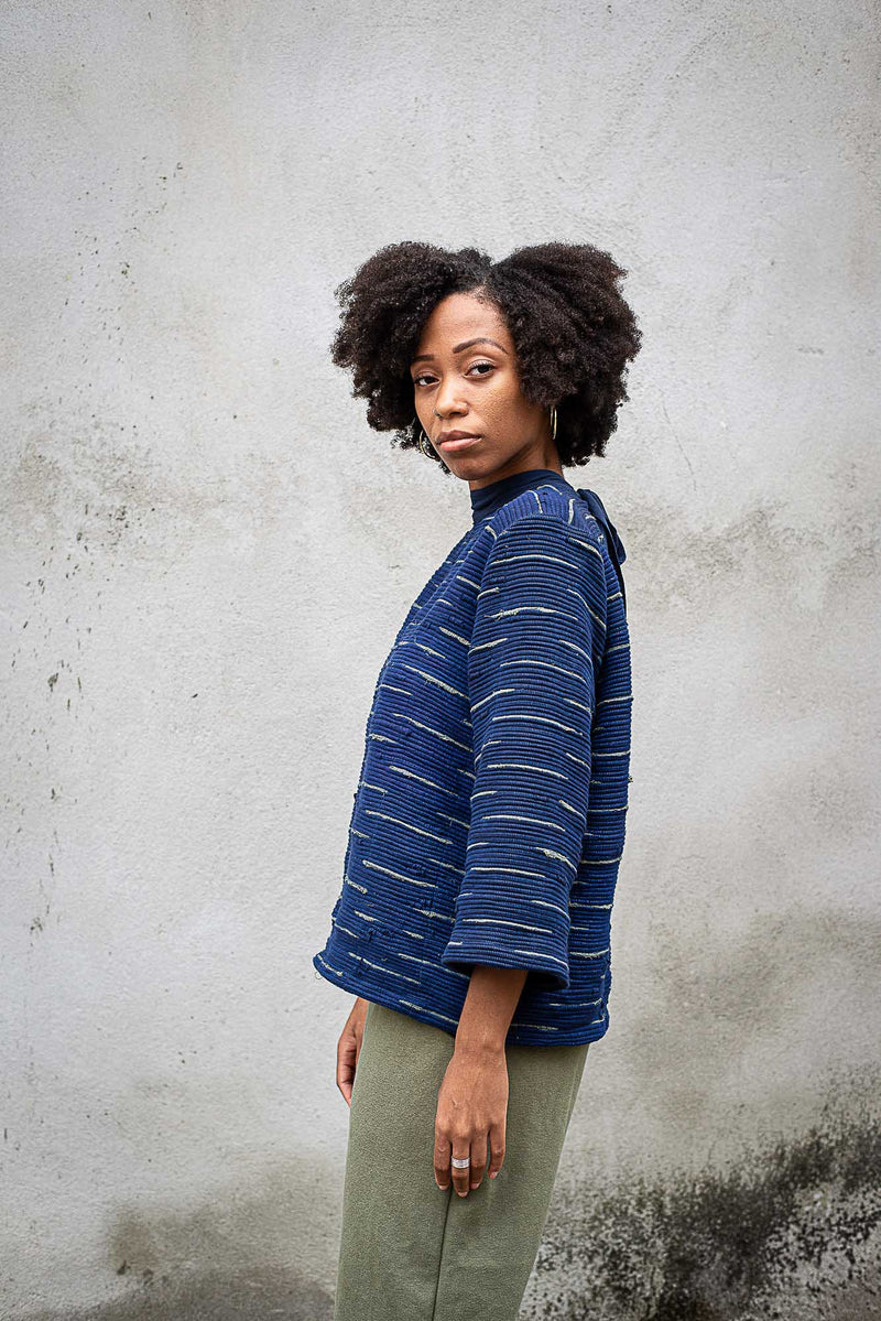 A side view of our Seyha sweater that shows the slightly cropped sleeve.