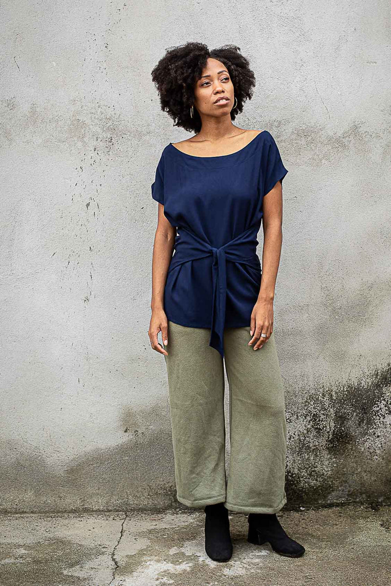 The sustainably made Sofia top, seen here in navy, can be paired with your favorite trousers.