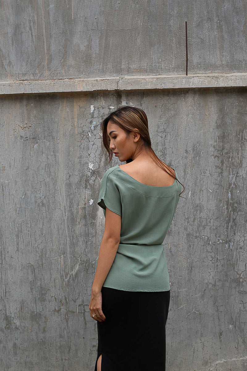 A back view of the Sofia top that shows the cut of the neckline and sleeves. Ethically made in our fair fashion workshop.