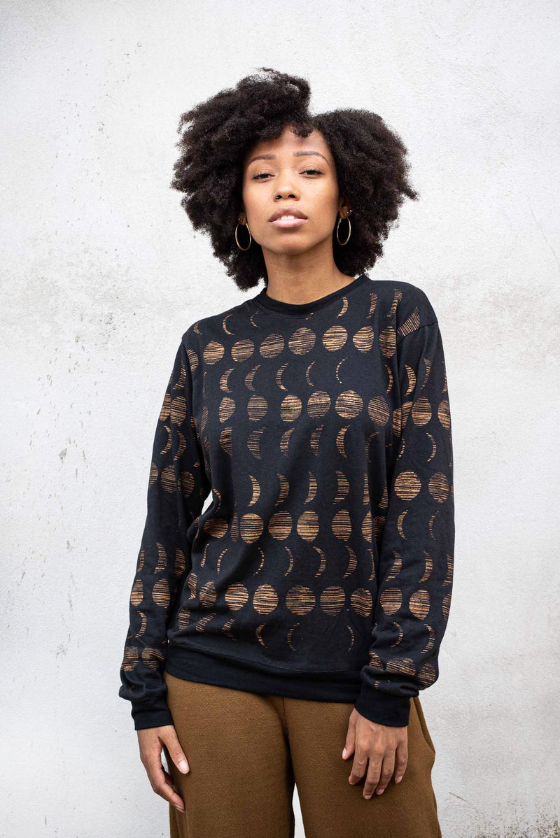 Our Sokha top, seen here in black with a moon cycle print, is ethically made.