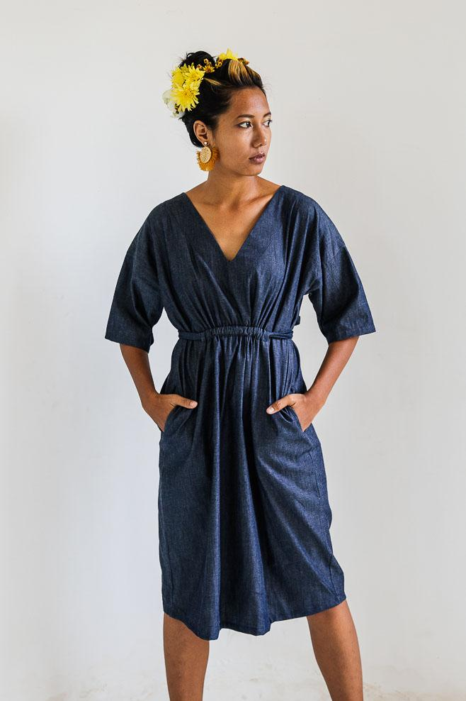 There are two pockets in our Sothea dress, seen here in navy.