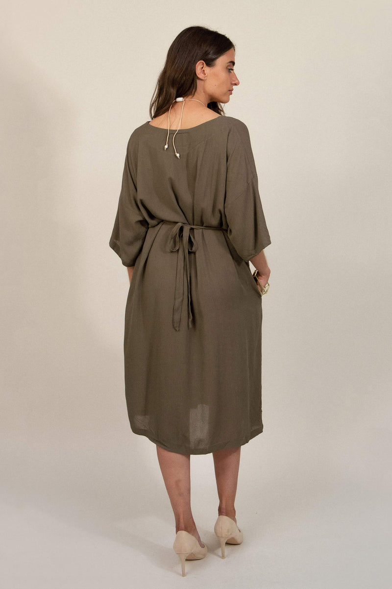 A back view of our sustainably made Sothea dress that shows the drawstring waist tied in a bow.