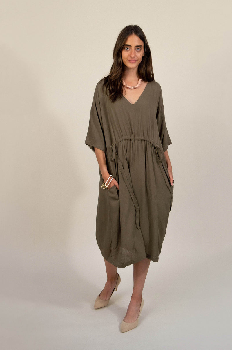 Our Sothea dress, shown here in olive, is a staple for any sustainable fashion capsule wardrobe.