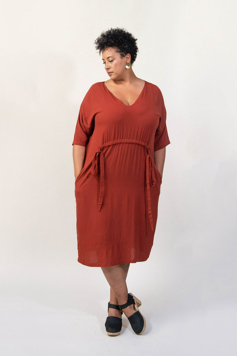 Our fair fashion Sothea dress can be worn in with a boxy silhouette by knotting the drawstring in the front.