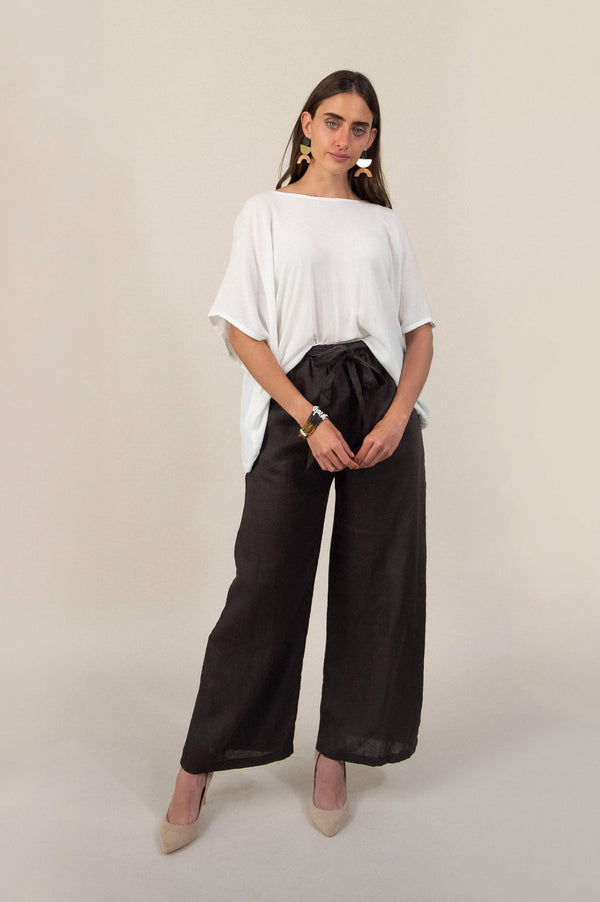 The Sothea pants are made from reclaimed textiles as part of our unique zero waste process. Seen here in black rayon.