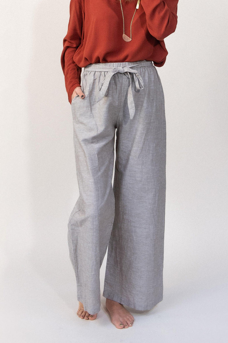 Our ethically made Sothea pants have a stylish front tie over an elastic waistband. Seen here in grey linen.