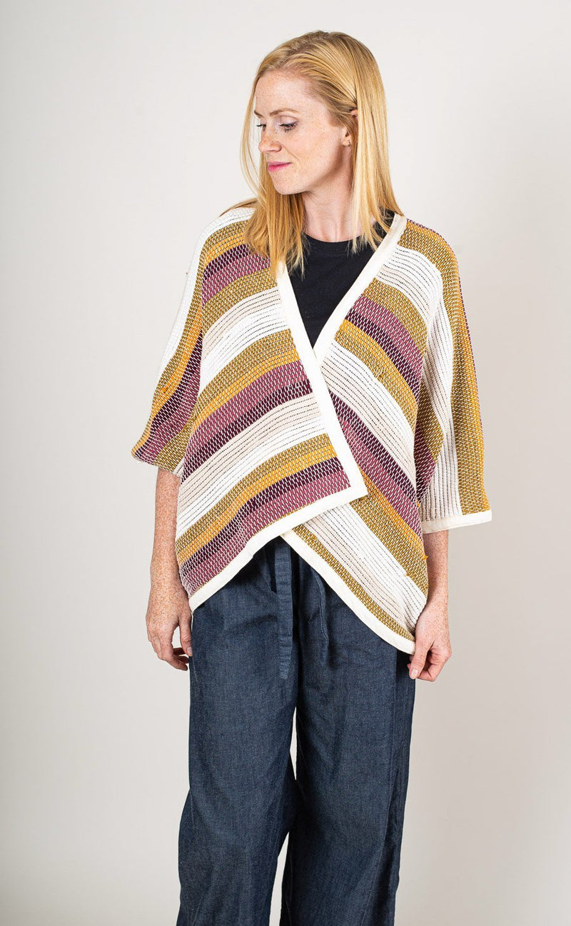 Our Srey cardigan, seen here in desert, can be layered over almost any look.