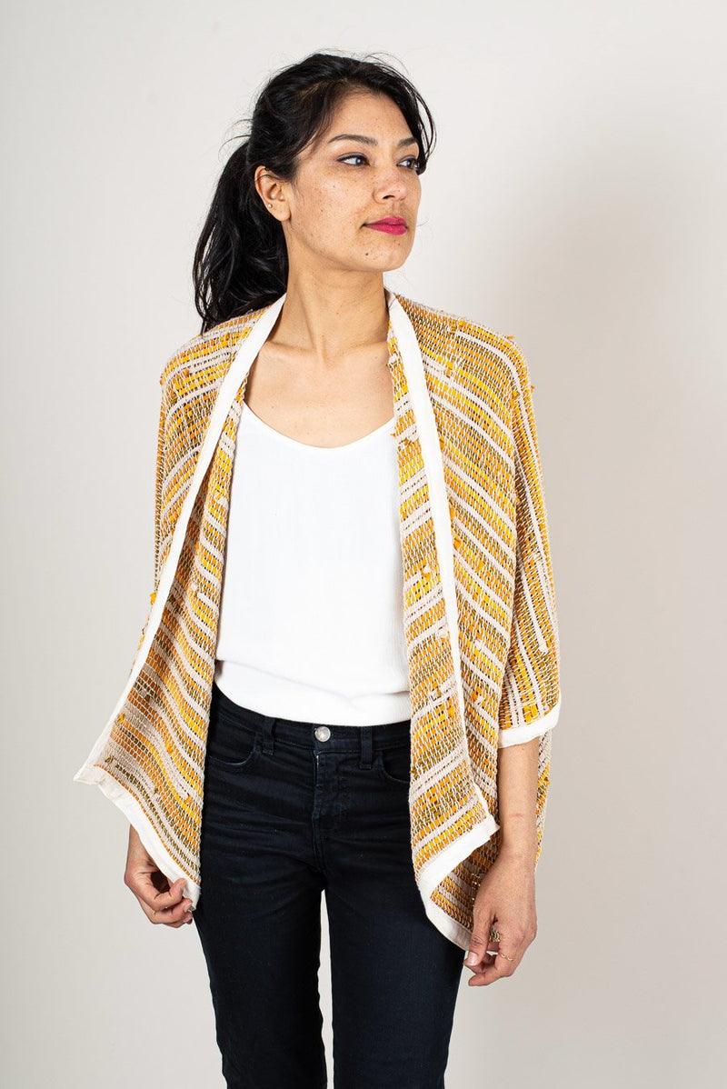 Our Srey cardigan, seen here in marigold, drapes beautifully and can be styled with a t-shirt and jeans.